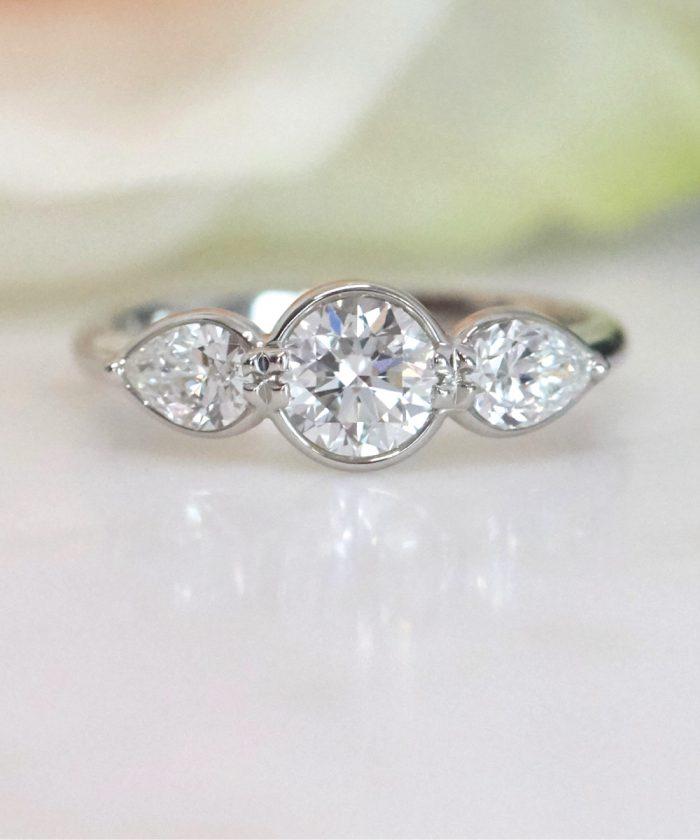 Unique Round Brilliant Diamond Trilogy Ring